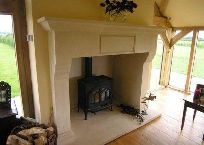 40e79bd01312efdb23dc1f964b139ef5--fire-surround-stone-fireplaces min